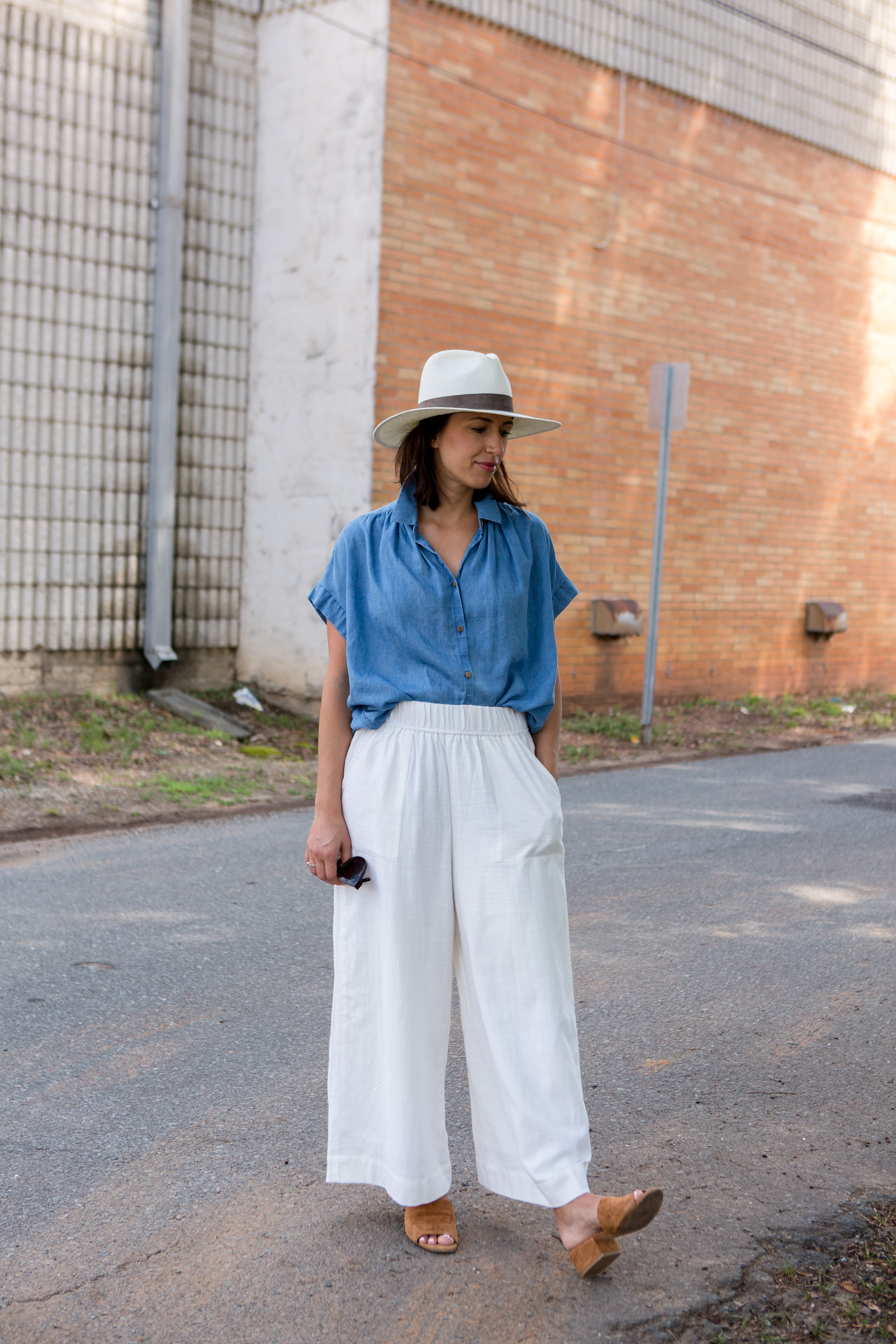 Outfit details: Wearing - Tribe Alive pants; Madewell top (old) (similar). Vince mules (old); Janessa Leone fedora